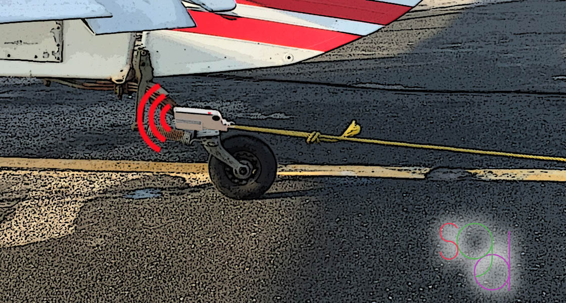 Wireless and bluetooth technology transmit a signal to release the tiedown from the tarmac.